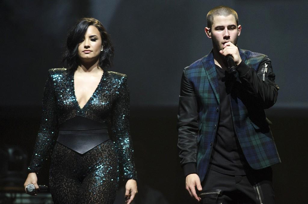 Demi Lovato and Nick Jonas perform during the 2016 Honda Civic Tour