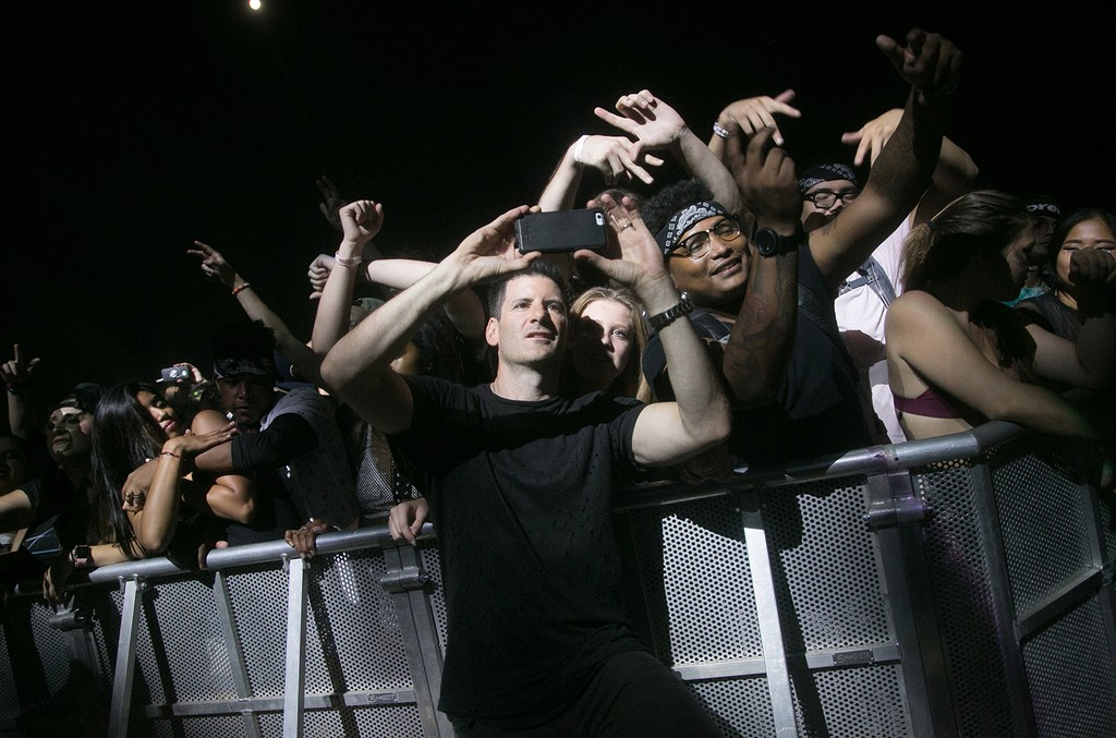 Gary Richards aka Destruco poses with fans at Hard Summer Music Festival