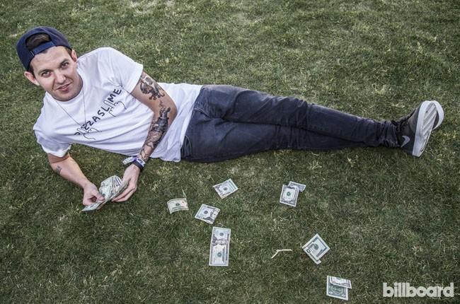 Dillon Francis counts his cash backstage during Coachella