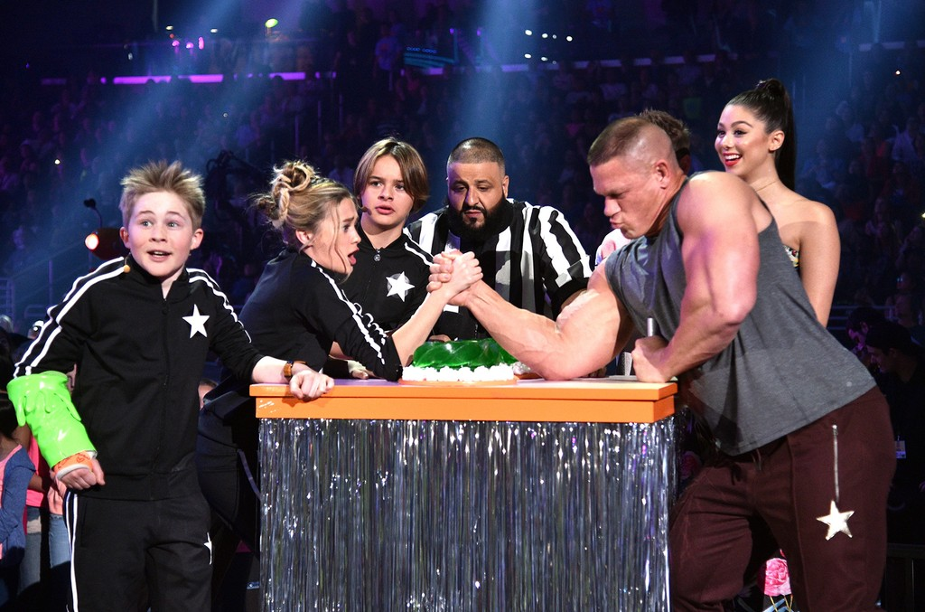 The cast of Nicky, Ricky, Dicky & Dawn armwrestle with host John Cena onstage with Dj Khaled at Nickelodeon's 2017 Kids' Choice Awards at USC Galen Center on March 11, 2017 in Los Angeles.