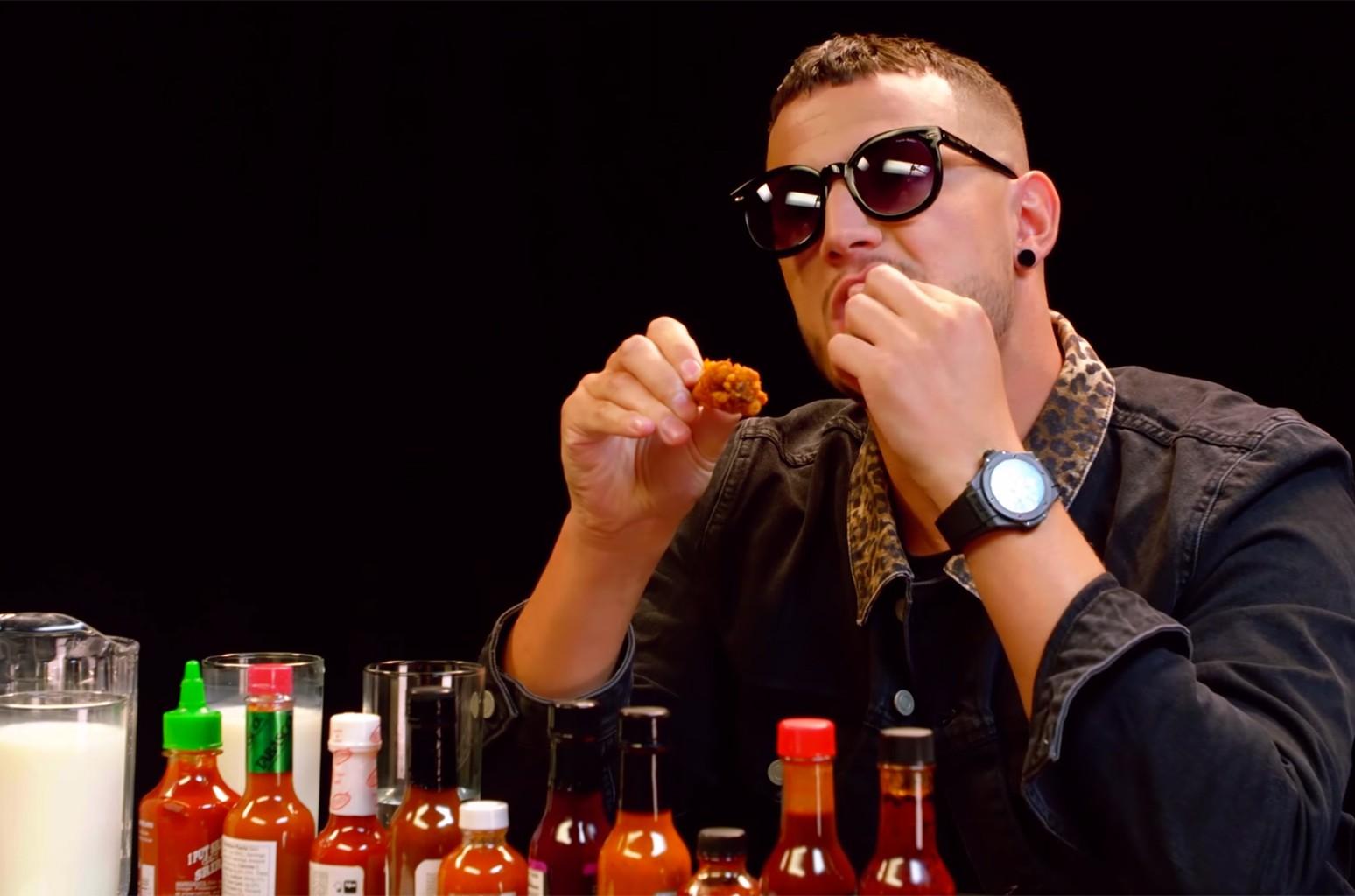 DJ Snake eats hot wings on 'First We Feast' episode.