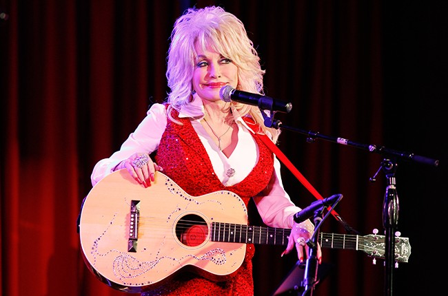 Dolly Parton performs at the Red Tent Women's Conference 2014