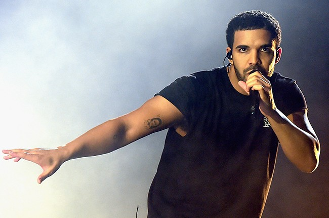 Drake performs onstage during day 3 of the 2015 Coachella