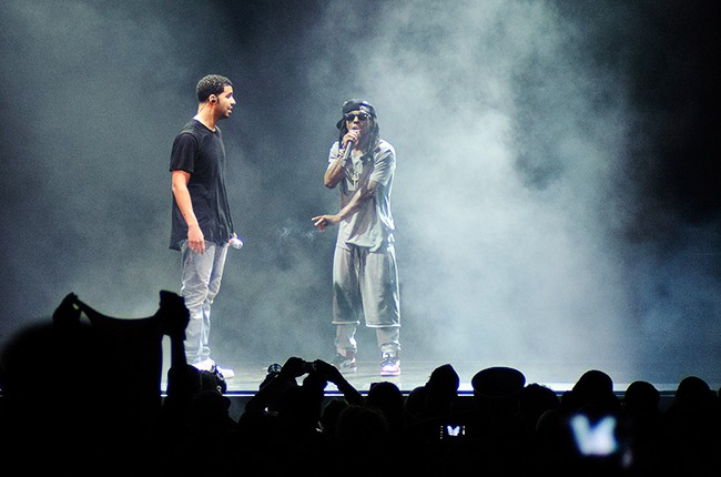 Drake and Lil Wayne perform outside Chicago