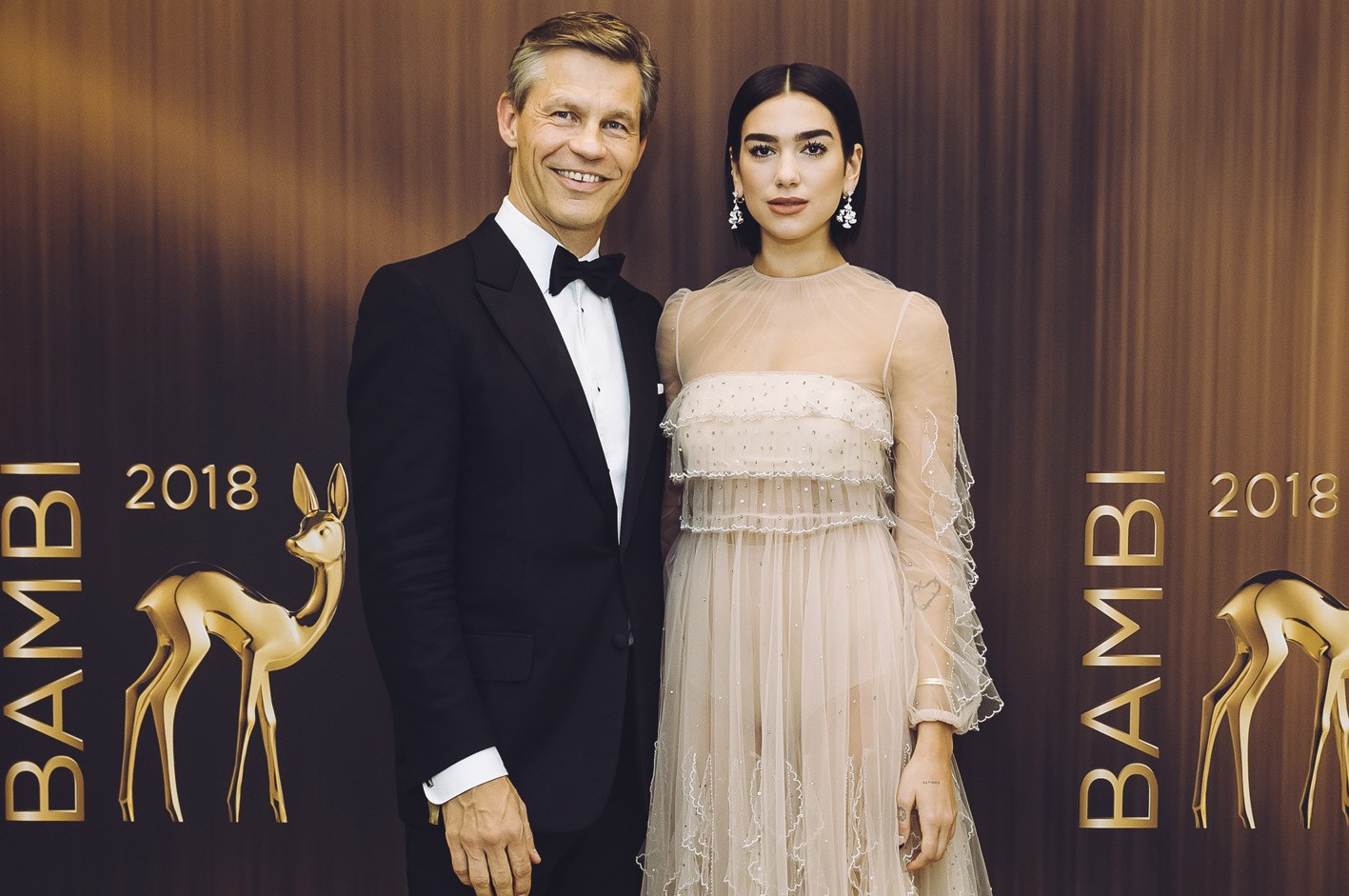 Frank Briegmann, President & CEO Central Europe Universal Music and Deutsche Grammophon, and Duo Lipa at the 2018 Bambi Awards