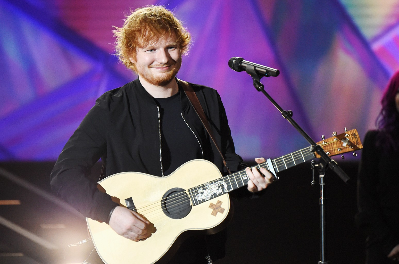 Ed Sheeran performs onstage at A+E Networks 'Shining A Light' concert at The Shrine Auditorium on Nov. 18, 2015 in Los Angeles.
