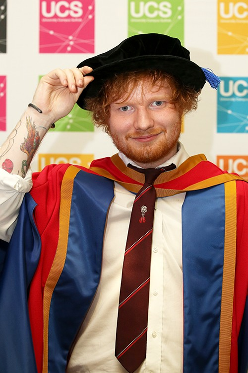 Ed Sheeran tries on his robes before receiving an honorary degree from University Campus Suffolk