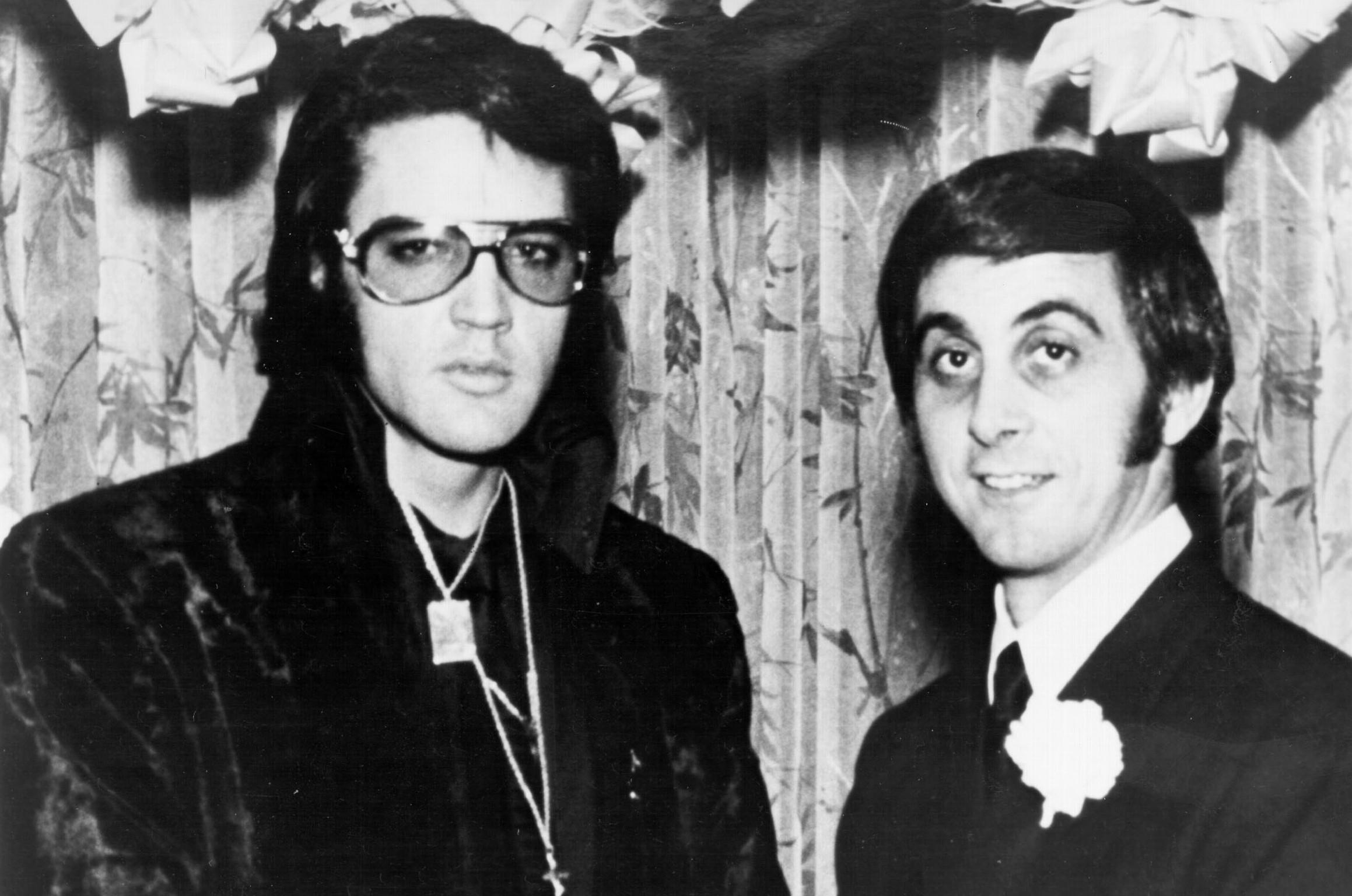 Elvis Presley with radio DJ and high school classmate George Klein in December of 1970 in Memphis, Tennessee.