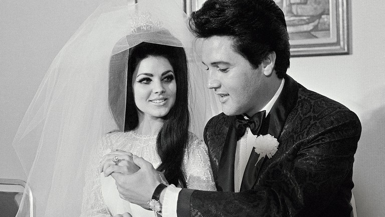 <p>Priscilla and Elvis Presley on their wedding day in 1967.</p>