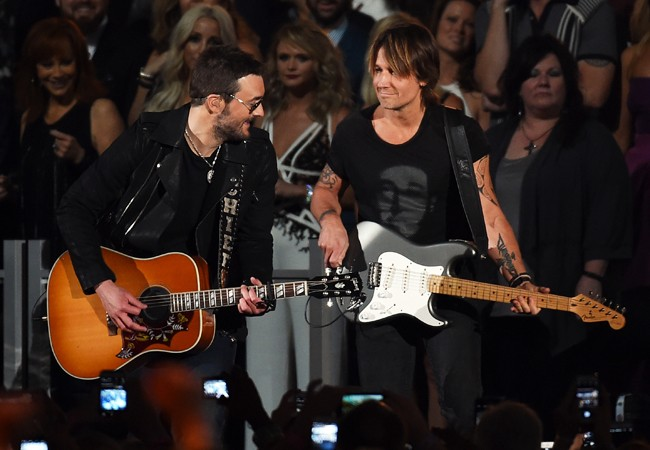 Eric Church and Keith Urban perform onstage during the 50th Academy Of Country Music Awards