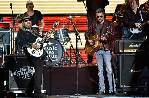 Hank Williams, Jr. and Eric Church perform onstage at the 49th annual CMA Awards