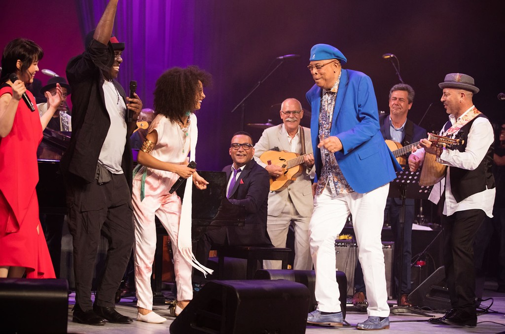 Esperanza Spalding, third from left, and Chucho Valdes, third from right, share a moment at the International Jazz Day concert in Havana on April 30, 2017.