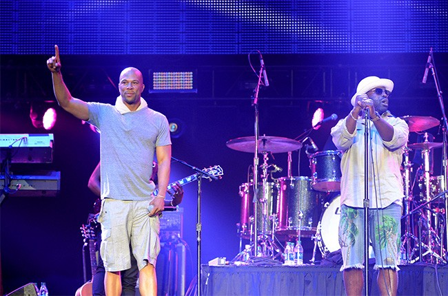 Common performs with The Roots at the 2014 Essence Music Festival