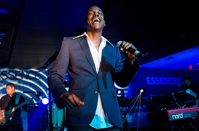 Tevin Campbell performs at the 2014 Essence Music Festival