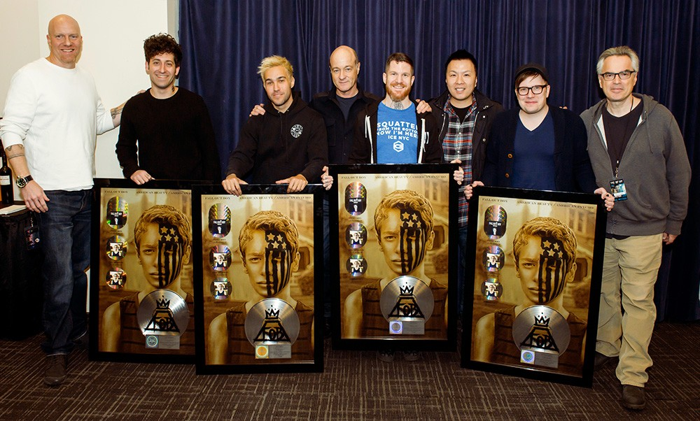 Fall Out Boy presented with plaques for several songs of their gold certified album, American Beauty/American Psycho, going platinum on March 4, 2016 backstage at Madison Square Garden in New York City.