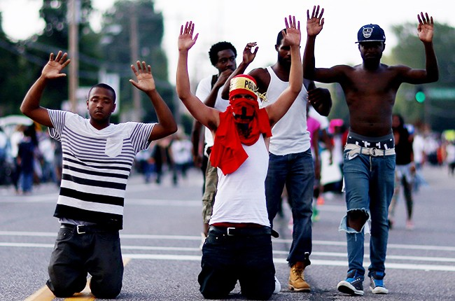 Demonstrators protesting the shooting death of Michael Brown in Ferguson, Missouri
