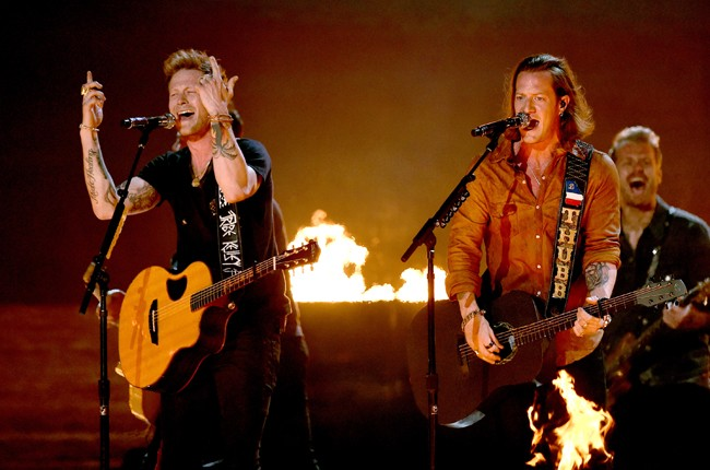 Brian Kelley and Tyler Hubbard of Florida Georgia Line perform onstage during the 50th Academy Of Country Music Awards