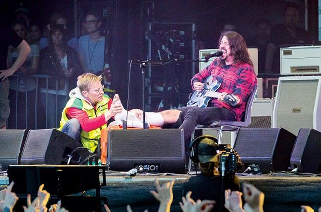 Dave Grohl of the Foo Fighters performs on stage after breaking his leg during the performance in June 12, 2015.