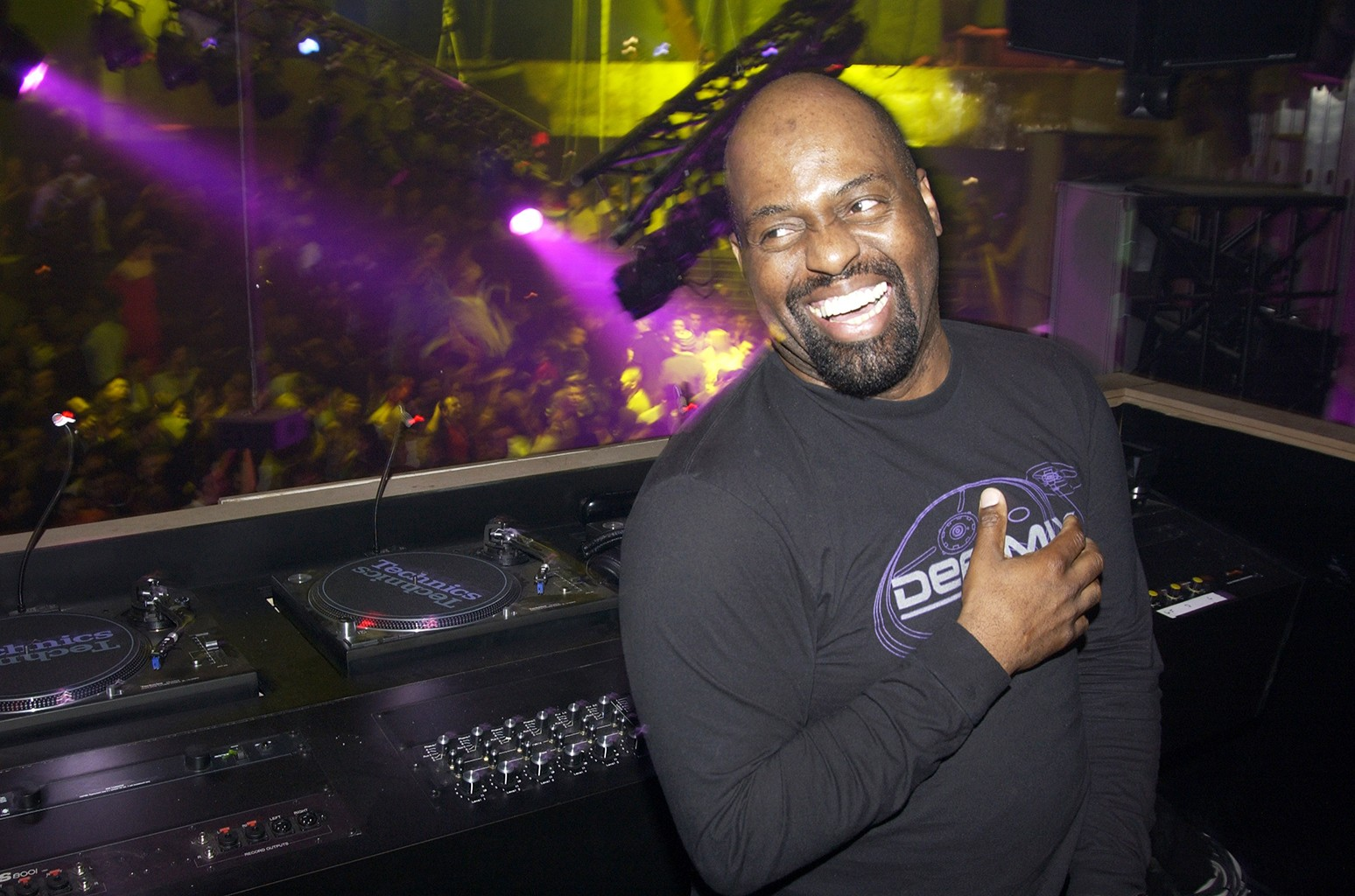Frankie Knuckles in the DJ booth during the opening night party at the Crobar in New York City.