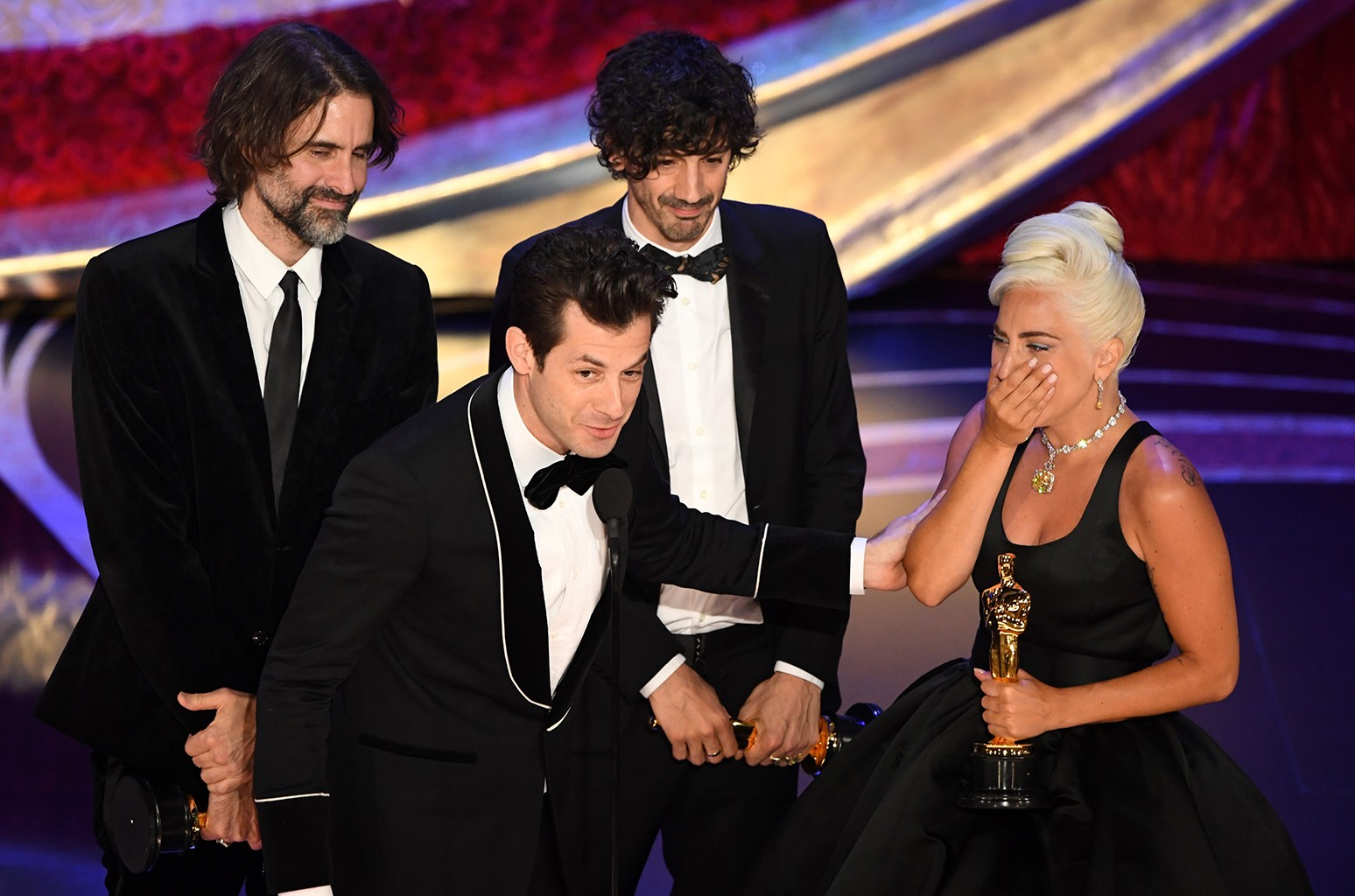 """Best Original Song nominees for """"Shallow"""" from """"A Star is Born"""" Lady Gaga, Mark Ronson, Anthony Rossomando and Andrew Wyatt accept the award for Best Original Song during the 91st Annual Academy Awards at the Dolby Theatre in Hollywood on Feb. 24, 2019."""