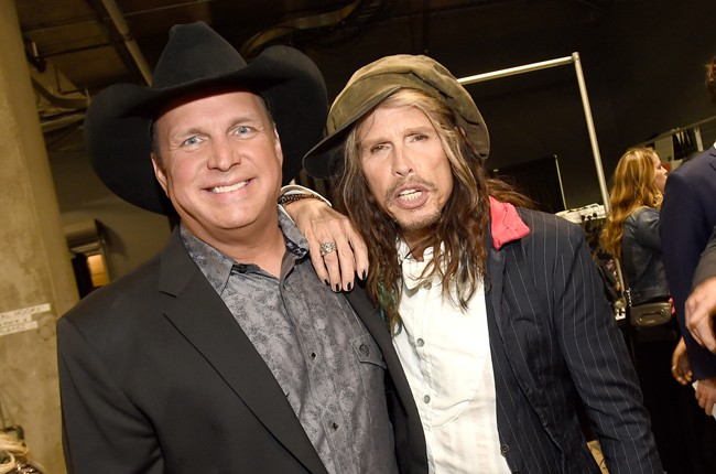 Garth Brooks and Steven Tyler pose backstage at the 50th Academy Of Country Music Awards