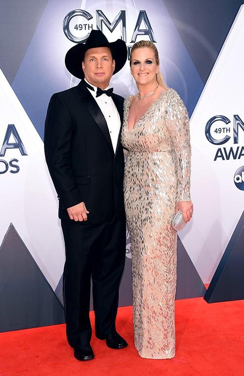 Garth Brooks and Trisha Yearwood attend the 49th annual CMA Awards