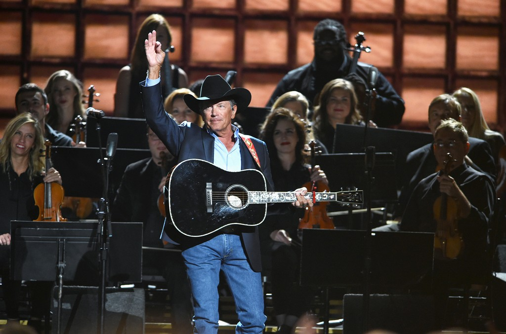 George Strait performs onstage at the 50th annual CMA Awards