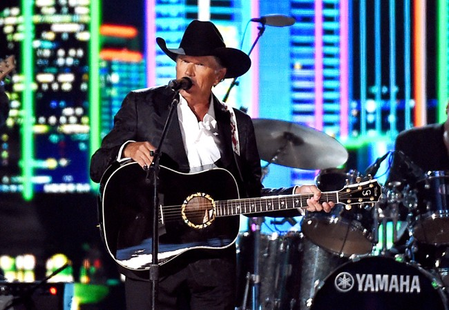 George Strait performs onstage during the 50th Academy Of Country Music Awards