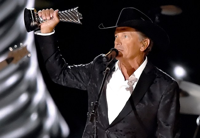 Honoree George Strait accepts the Milestone Award onstage during the 50th Academy Of Country Music Awards