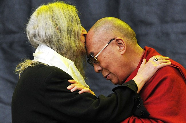 Dalai Lama joins Patti Smith on the Pyramid stage during the third day of Glastonbury