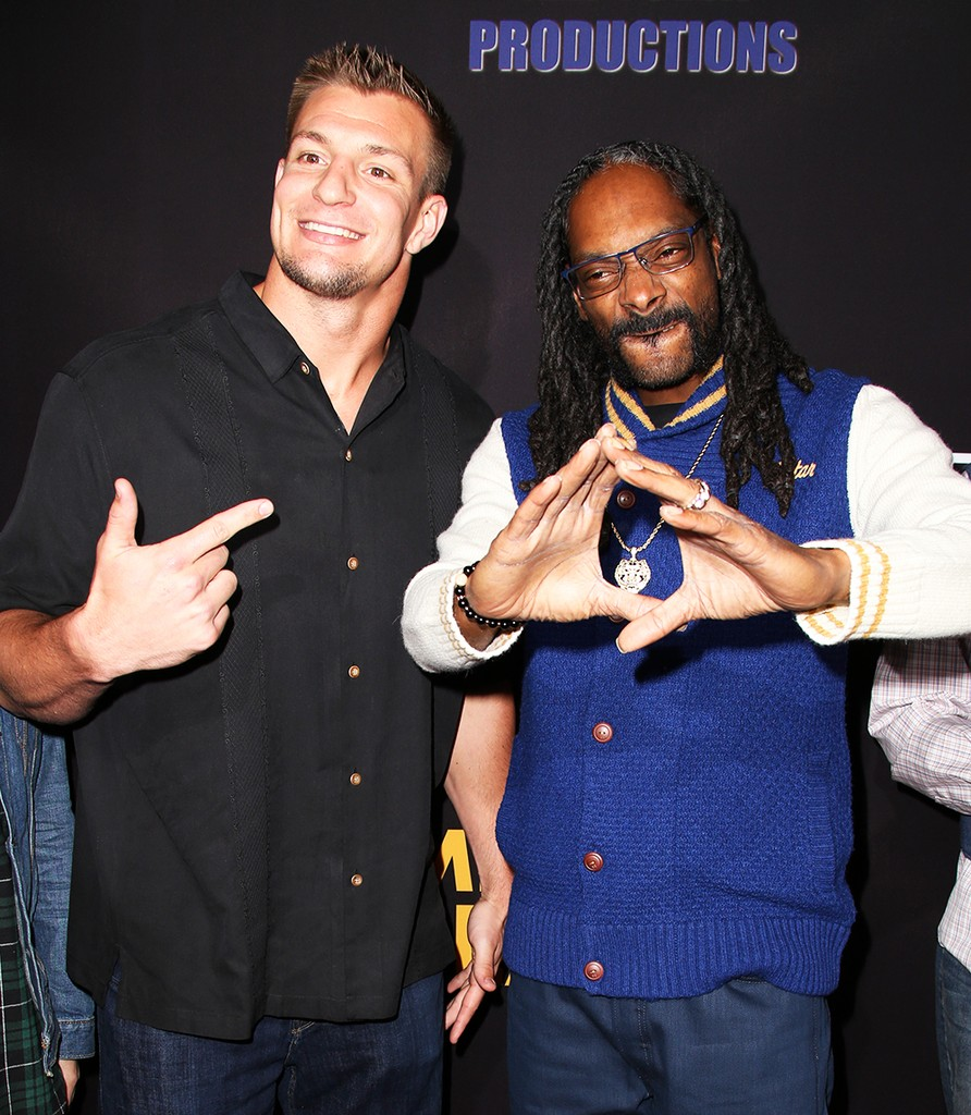"""Rob """"Gronk"""" Gronkowski and Snoop Dogg attend the premiere of Freestyle Releasing's Meet The Blacks at ArcLight Hollywood on March 29, 2016 in Hollywood, Calif."""