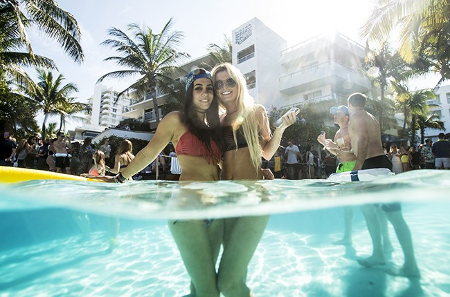 Attendees enjoy the pool party at Red Bull Guest House in Miami, Fla., March 29, 2015.