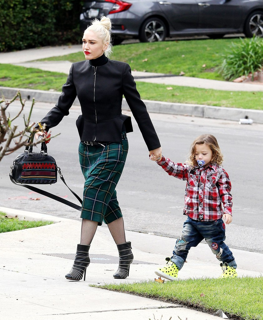 Gwen Stefani layered a black jacket over a turtleneck sweater, paired with a set of plaid harem trousers while attending church services with son Apollo Rossdale, on Jan. 15, 2017 in Los Angeles.