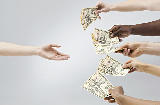 Hands Holding out Money