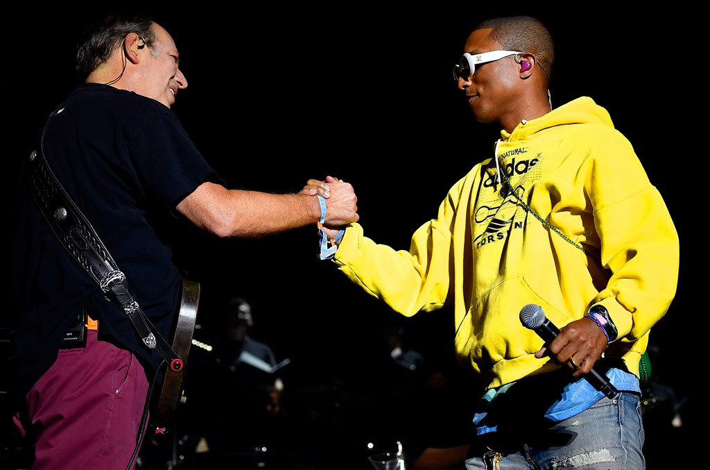 Hans Zimmer and Pharrell Williams embrace onstage at the Outdoor Theatre during day 3 of the Coachella Valley Music And Arts Festival (Weekend 1) at the Empire Polo Club on April 16, 2017 in Indio, Calif.