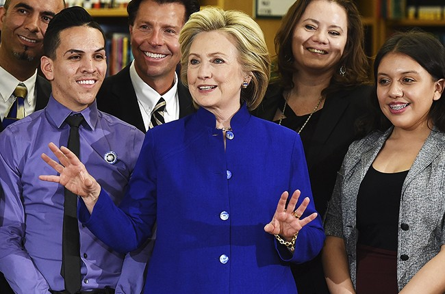 Democratic presidential candidate and former U.S. Secretary of State Hillary Clinton poses with students and faculty after speaking at Rancho High School on May 5, 2015 in Las Vegas, Nevada.