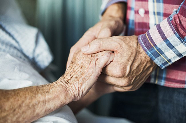 hospital-patient-holding-hands