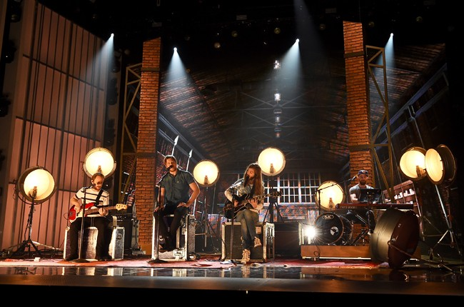 Imagine Dragons rehearse onstage during the 2015 Billboard Music Awards