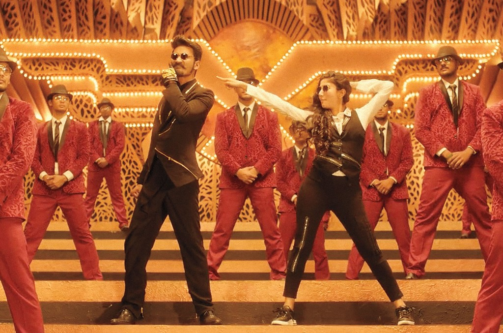 """Dhanush (left, in black) and Dhee in the """"Rowdy Baby"""" music video."""