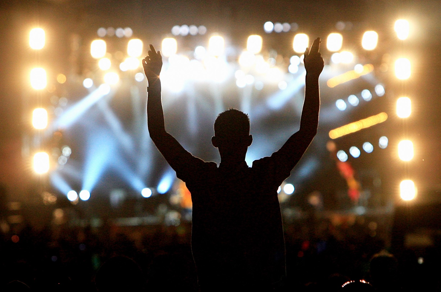 A festival goer cheers at the Isle of Wight Festival.