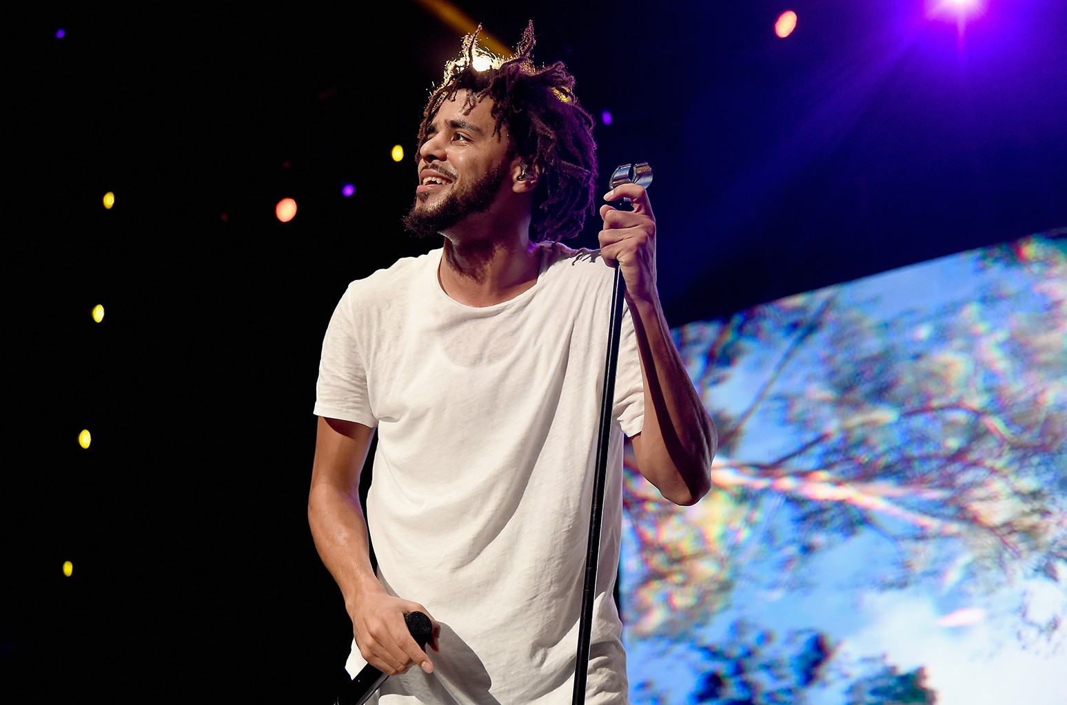 J. Cole performs onstage during the 2016 Billboard Hot 100 Festival