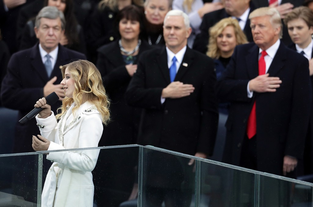 Jackie Evancho performs the National Anthem as Vice President Mike Pence and President Donald Trump watch on the West Front of the U.S. Capitol on January 20, 2017 in Washington, DC. In today's inauguration ceremony Donald J. Trump becomes the 45th pres