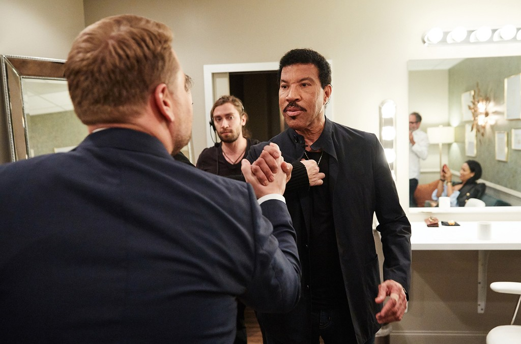 """Lionel Richie chats in the green room with James Corden during """"The Late Late Show with James Corden on May 22, 2017."""
