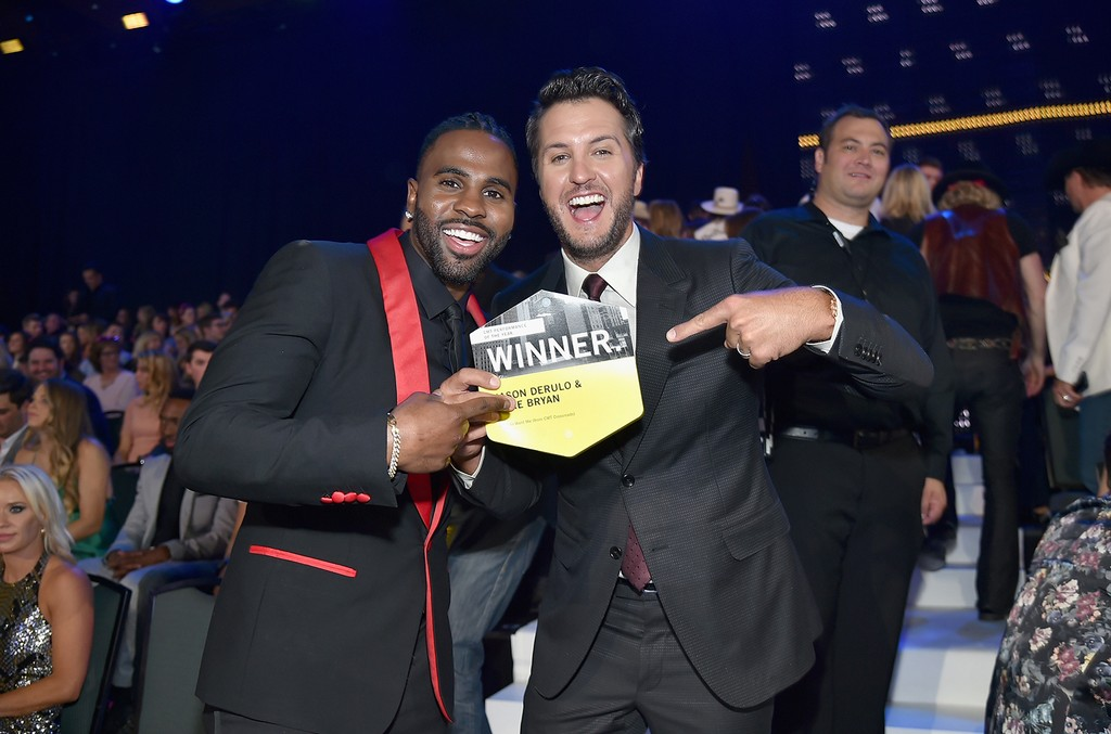Jason Derulo and Luke Bryan celebrate their win for Performance of the Year during the 2017 CMT Music awards at the Music City Center on June 7, 2017 in Nashville, Tenn.