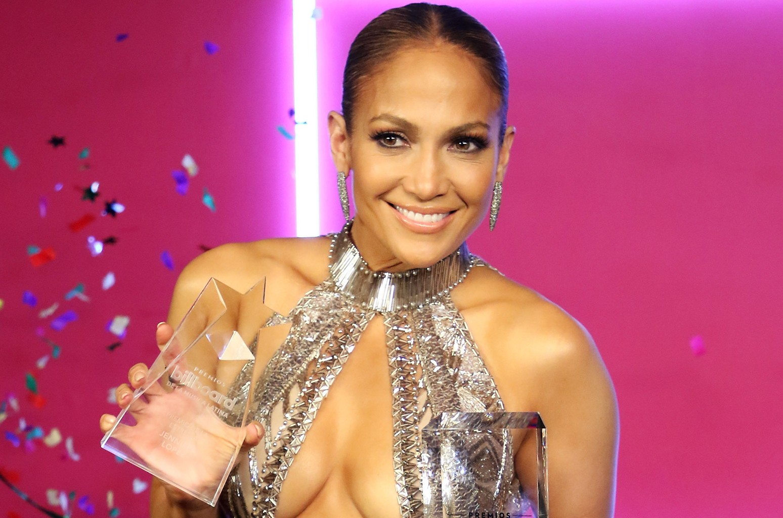 Jennifer Lopez poses with awards in the press room during the Billboard Latin Music Awards at Watsco Center on April 27, 2017 in Coral Gables, Fla.