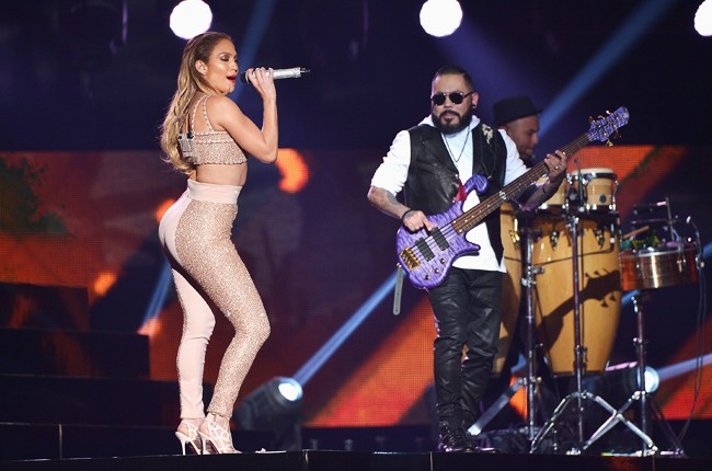 Jennifer Lopez performs musical tribute to Selena while performing with Los Dinos onstage at the 2015 Billboard Latin Music Awards