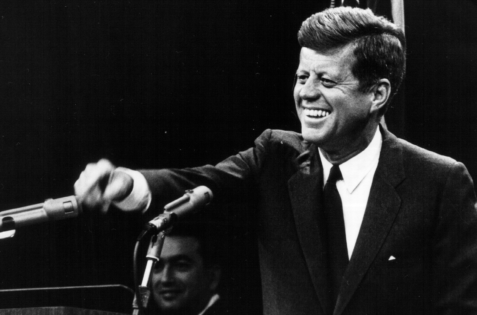 John F. Kennedy laughs during a press conference Aug. 9, 1963.