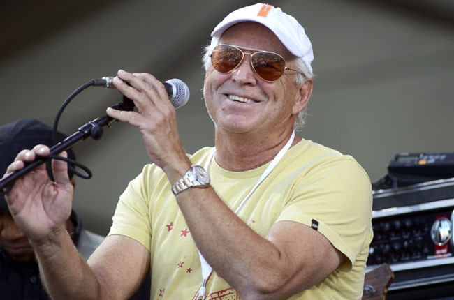 Jimmy Buffett performs as a special guest of Allen Toussaint during the 2014 New Orleans Jazz & Heritage Festival