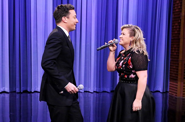 "Kelly Clarkson and host Jimmy Fallon during the ""History of Duets"""