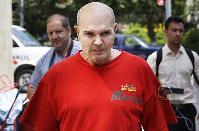 Hollywood record promoter and movie producer Joe Isgro leaves the courtroom in 2014